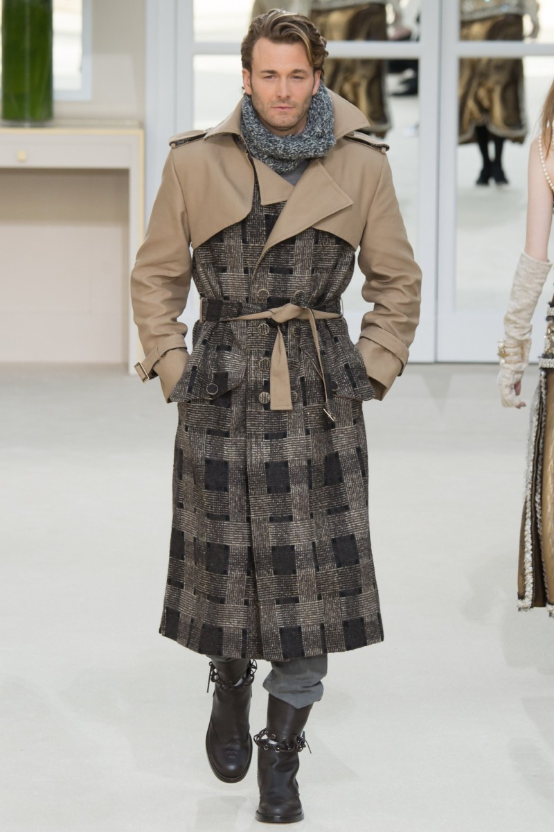 Brad Kroenig takes to the catwalk in a tweed trench from Karl Lagerfeld's fall-winter 2016 Chanel collection.