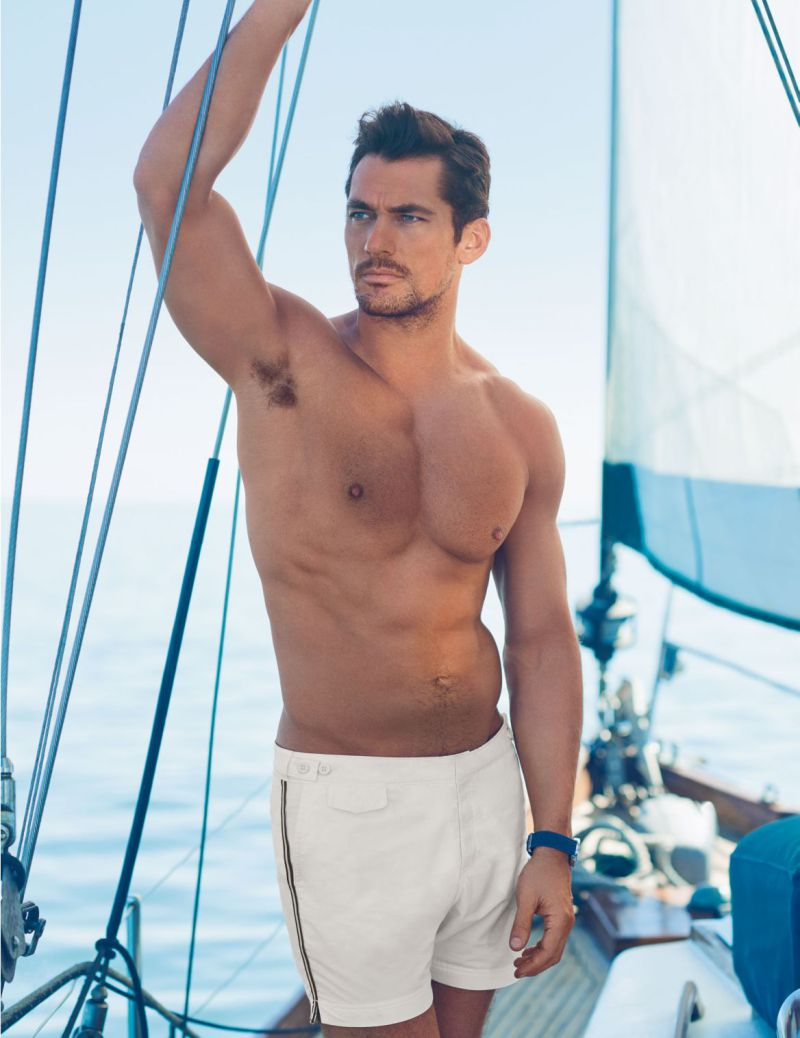 David Gandy is pictured in David Gandy for Autograph Tailored Fit Mid Length Quick Dry Swim Shorts from Marks & Spencer