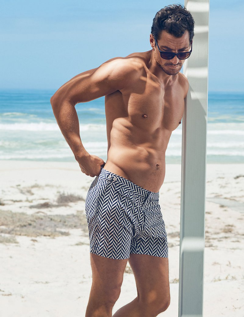 David Gandy embraces a zigzag print, wearing  his David Gandy for Autograph Tailored Fit Mid Length Quick Dry Swim Shorts from Marks & Spencer.