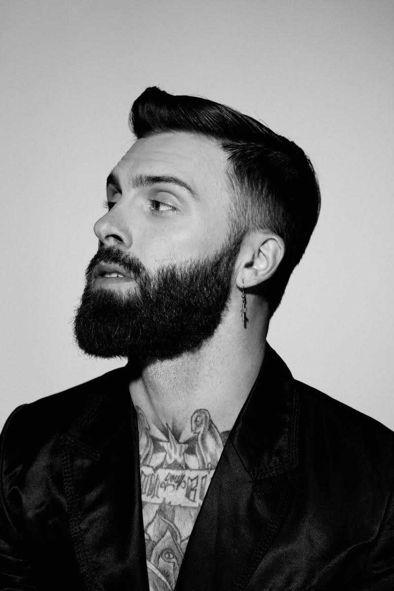 Levi Stocke embraces a smooth slicked hairstyle.