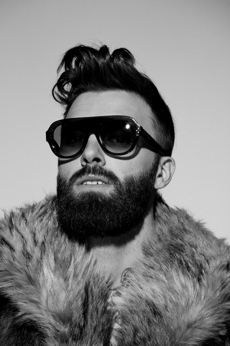 Levi Stocke plays it cool, embracing a poofy hairstyle.