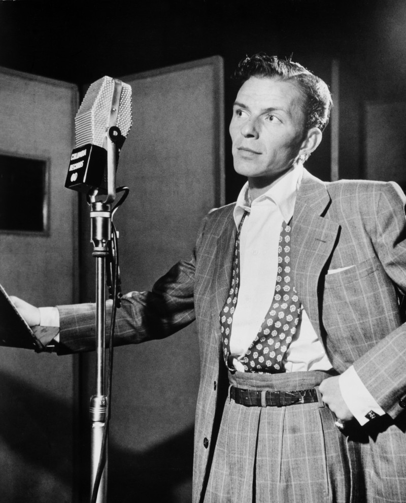 Frank Sinatra captures the spirit of the 1940s with an oversized windowpane suit that features high waist trousers.