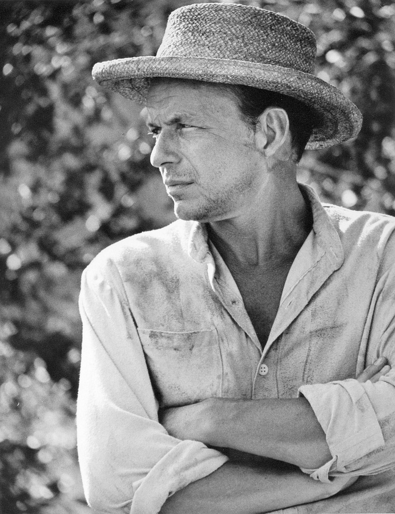 Frank Sinatra sports a straw hat for this 1960s photo.