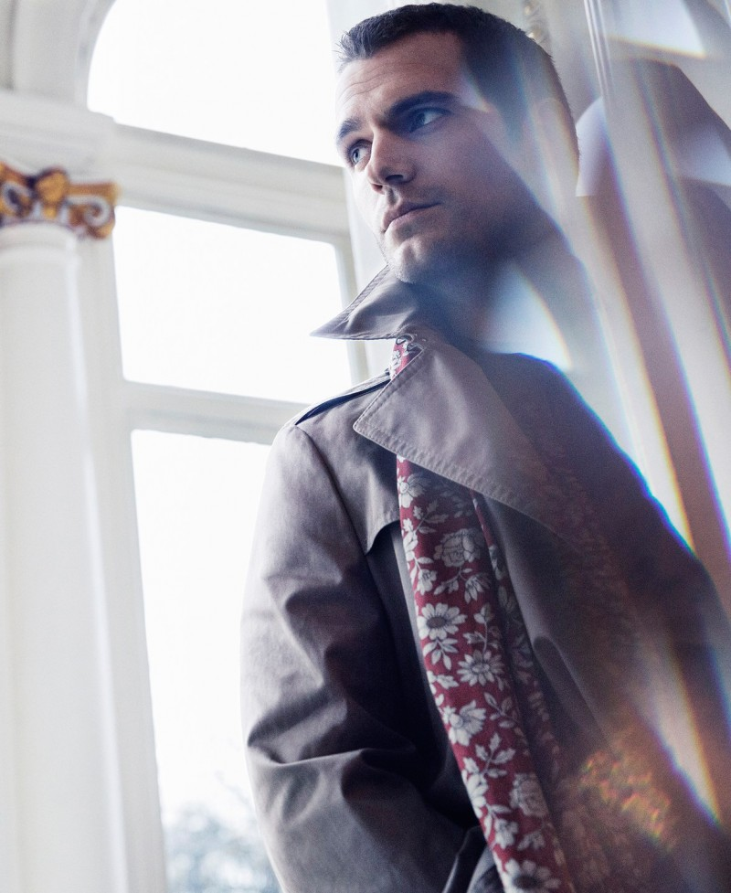 Henry Cavill sports a trench coat with a printed scarf for the pages of Sharp magazine.