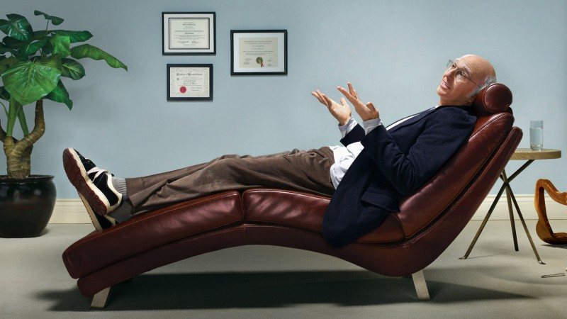 Larry David relaxes in Simple OS black sneakers.