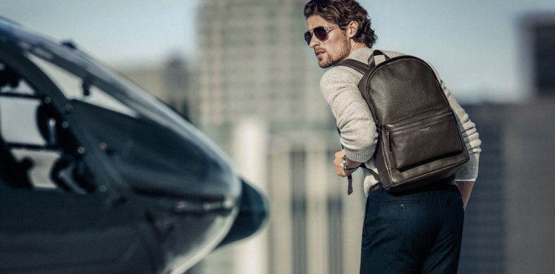 Pictured with a leather backpack, model Wouter Peelen stars in Michael Kors' spring-summer 2016 campaign.