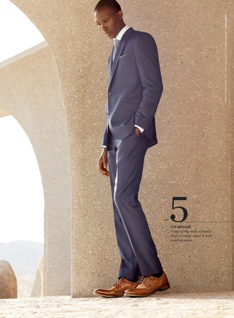 Armando Cabral dons a grey Ted Baker London suit with brown leather wingtip shoes.