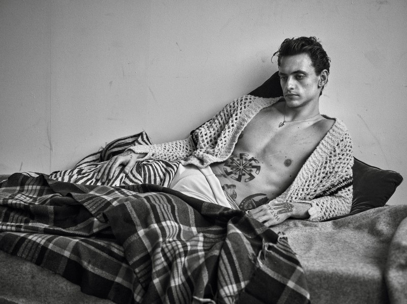 Sergei Polunin styled by Anastasia Barbieri in an open cardigan for Vogue Hommes Paris.