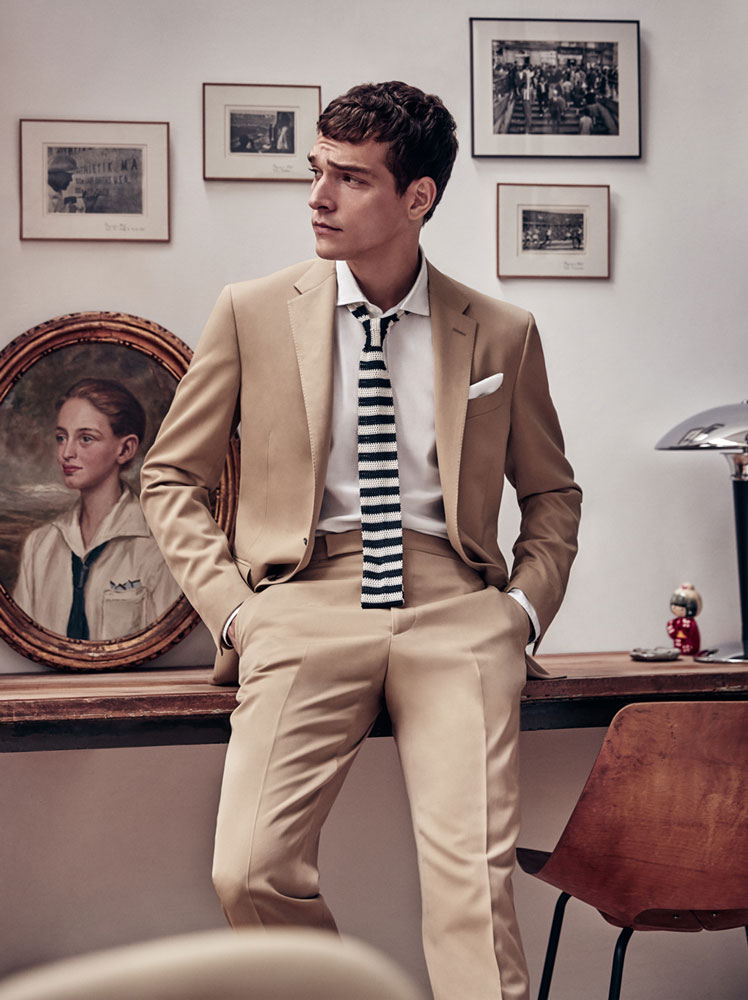 Alexandre Cunha is front and center in a camel Polo Ralph Lauren suit.