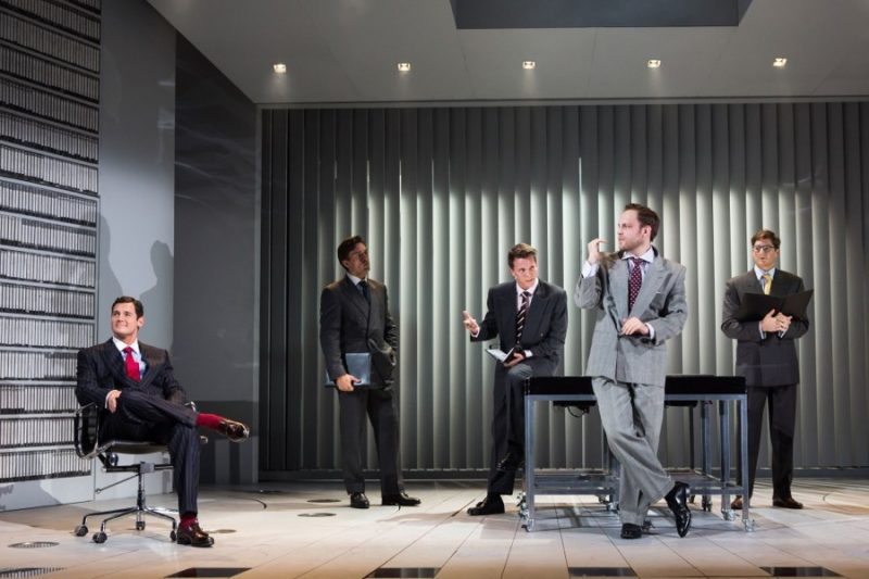 Patrick Bateman (Benjamin Walker) takes to the office in a dashing pinstripe suit, accented with a red tie and socks for American Psycho: The Musical.