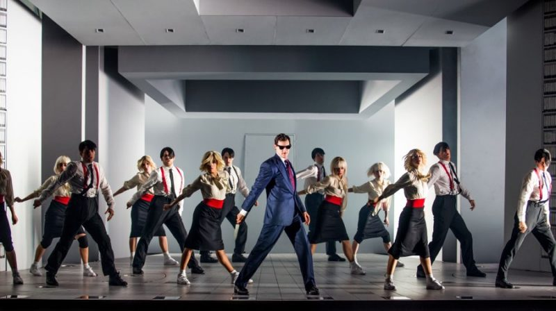 Benjamin Walker suits up in navy for a dance number as Patrick Bateman in American Psycho: The Musical.
