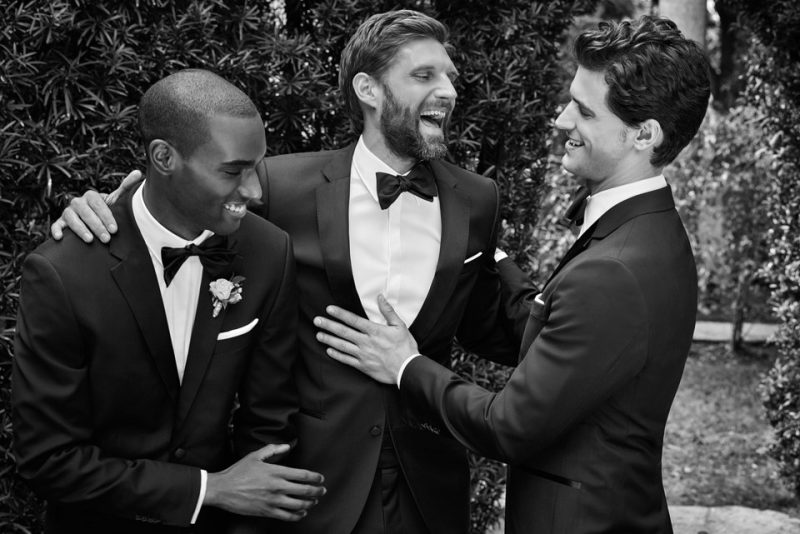 Corey Baptiste, RJ Rogenski and Garrett Neff are in a celebratory mood as they connect with BOSS Hugo Boss for its grand tuxedo outing.