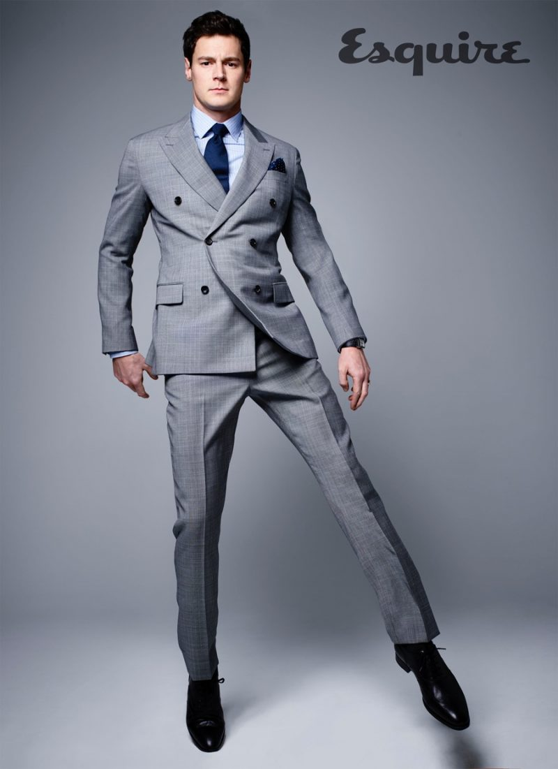 Benjamin Walker dons a grey double-breasted suit for an Esquire photo shoot.