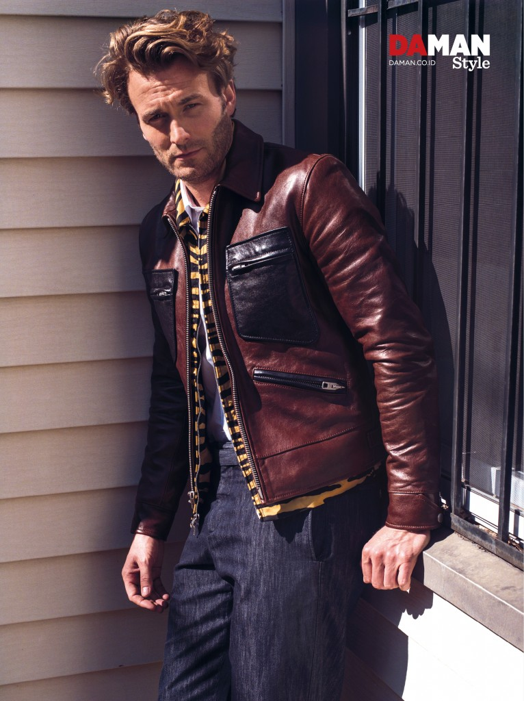 Brad Kroenig makes a luxe statement in leopard and a leather jacket from Coach.