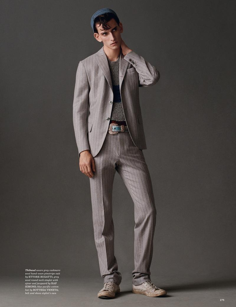 Thibaud Charon embraces soft spring sentiments in a grey pinstripe suit from Ettore Bugatti.