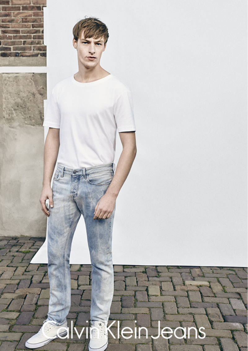Roberto Sipos models a classic white tee and denim jeans for Calvin Klein Jeans.