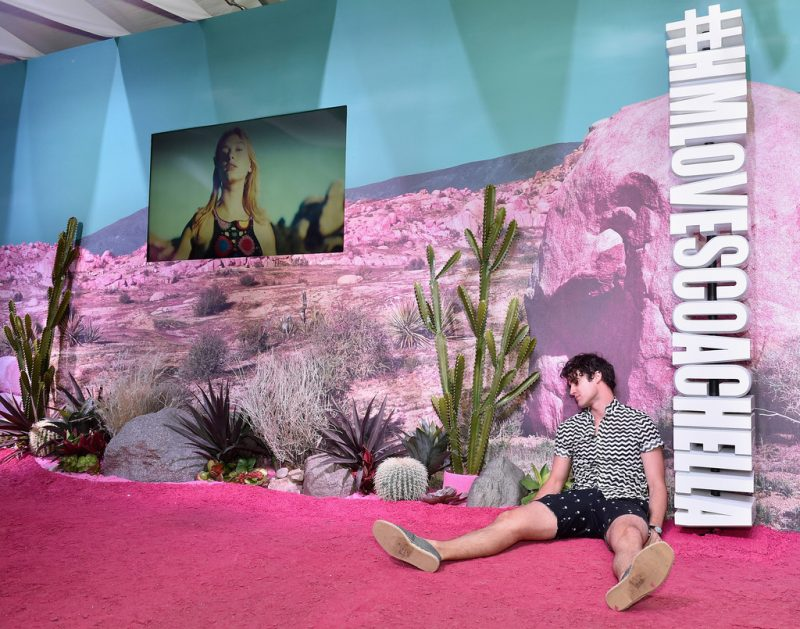 Darren Criss poses for a cheeky picture at the H&M Love Coachella Pop Up.