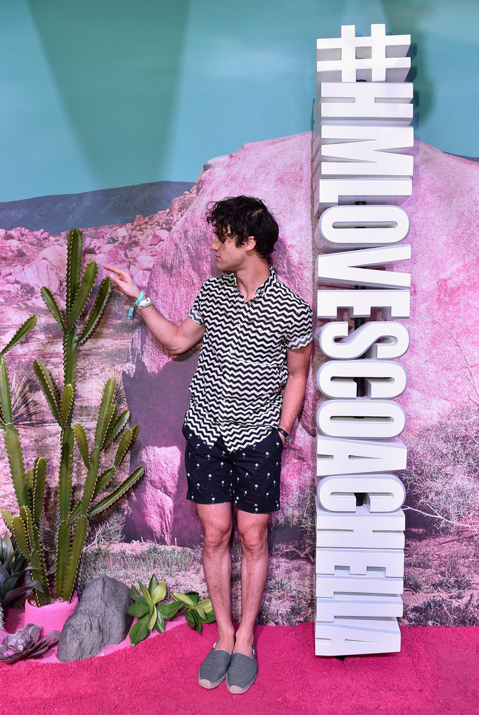 Darren Criss takes in the atmosphere at the H&M Loves Coachella Pop Up.