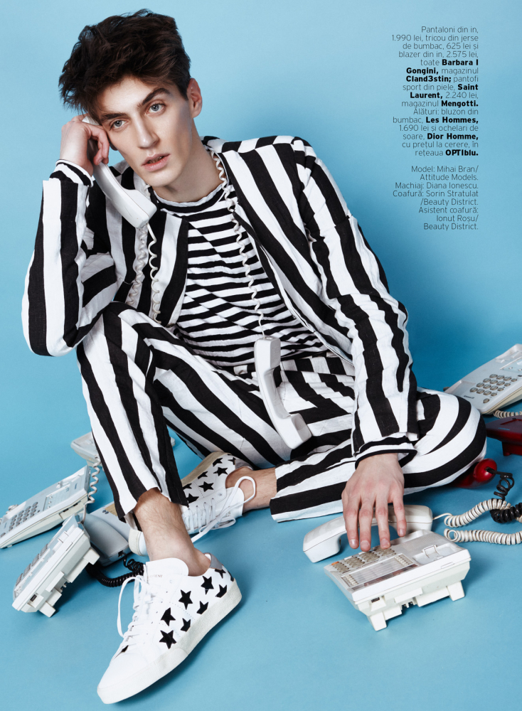Mihai Bran makes a graphic statement in a striped ensemble for a shoot in Elle Man Romania.