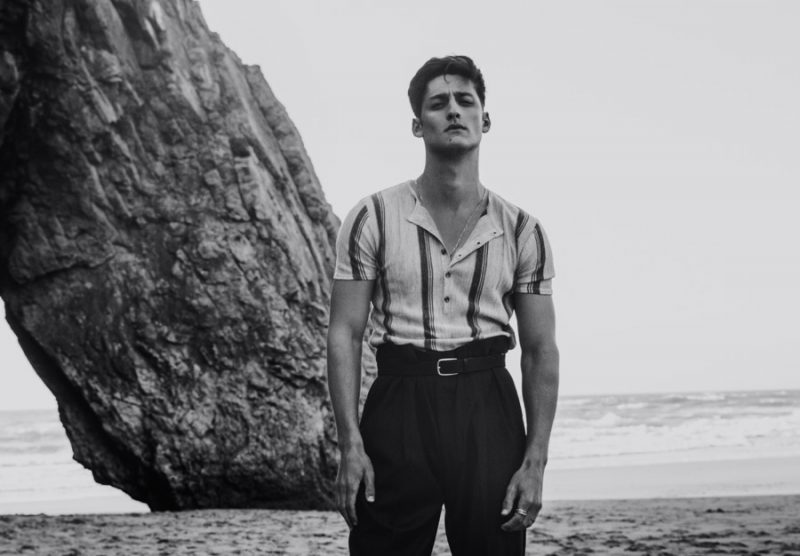 Carlos wears henley shirt and belt Zara, vintage trousers Yves Saint Laurent and necklace worn throughout story model's own.