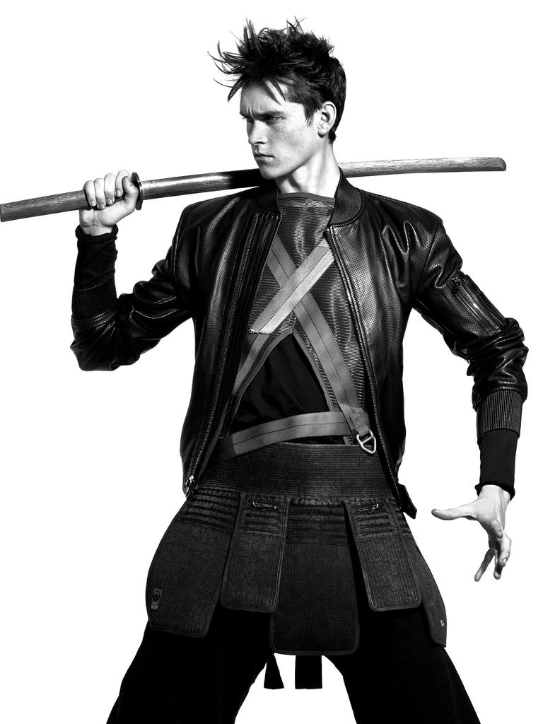 Anders Hayward wears jacket Ralph Lauren, mesh vest Wooyoungmi, top Acne Studios and trousers Vivienne Westwood.