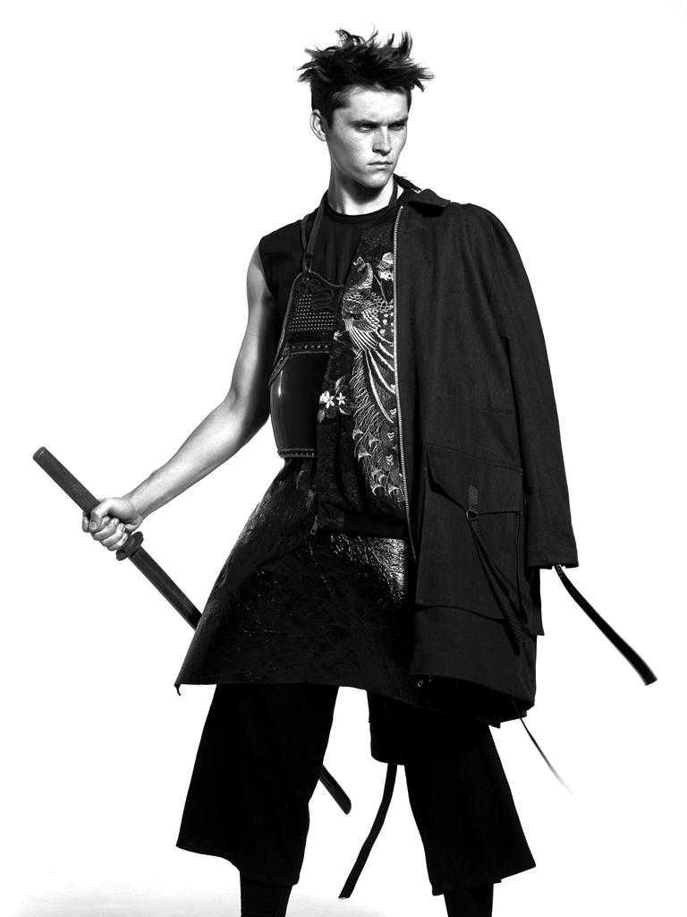 Anders Hayward wears coat Adyn, jacket Dolce & Gabbana, tunic Rick Owens and trousers JUUN.J.