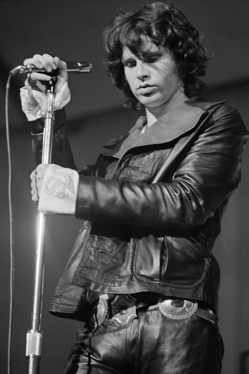 Jim Morrison doubles down on leather, wearing a cool jacket and form-fitting pants while performing.