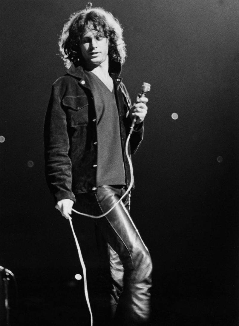 Jim Morrison takes the stage in a suede jacket and leather pants.