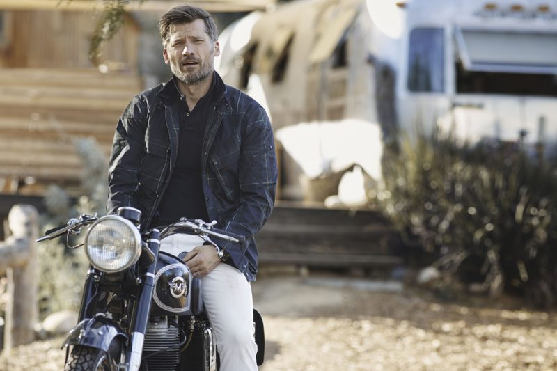 Pictured in a plaid jacket, Nikolaj Coster-Waldau goes casual on the back of a bike.