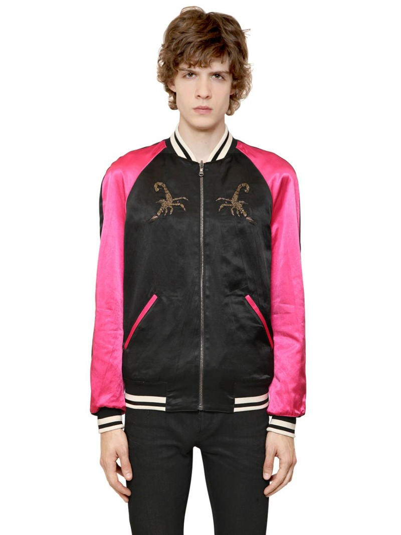 Roberto Cavalli Satin Souvenir Jacket: Italian fashion brand Roberto Cavalli is ready to dress the king of cool with its hot pink and black take on the iconic souvenir jacket.