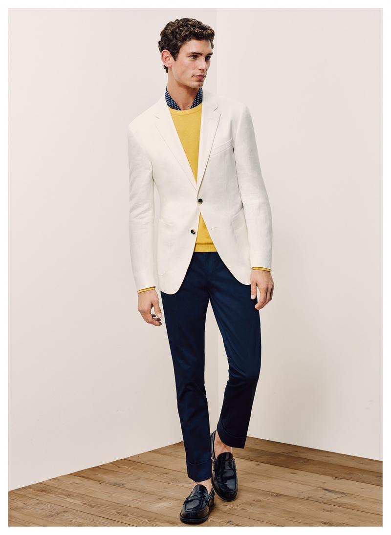 Arthur Gosse embraces smart suiting separates from Tommy Hilfiger Tailored, wearing navy and white together.