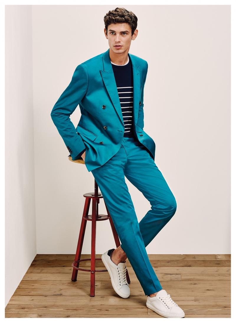 Arthur Gosse wears a Tommy Hilfiger Tailored double-breasted turquoise suit with a lightweight breton stripe sweater.