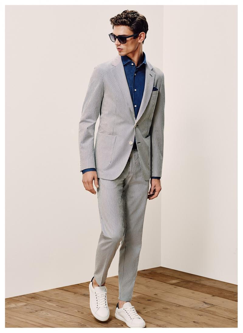 Arthur Gosse is a sleek vision in a grey seersucker suit from Tommy Hilfiger Tailored.