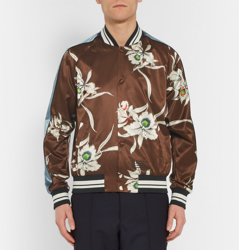 Valentino Printed Satin Souvenir Jacket: Valentino creative directors Maria Chiuri and Pier Piccioli make a strong case for the souvenir jacket with their gorgeous spin on the classic. The design duo embrace satin and oriental orchids for the statement jacket.