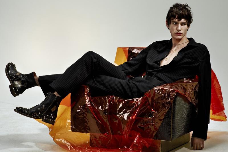 Elias de Poot dons a pinstripe suit from Salvatore Ferragamo.
