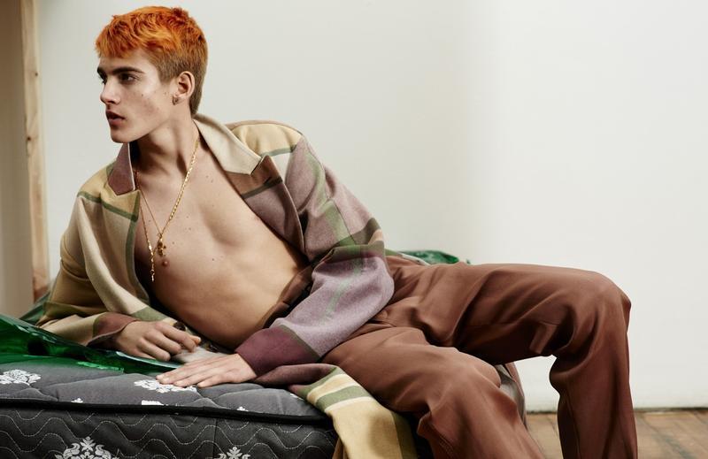 Presley Gerber dons a plaid coat from Ermenegildo Zegna Couture.