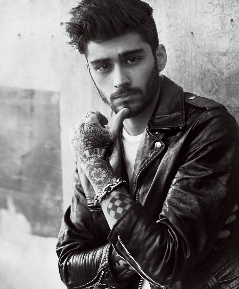 Zayn Malik photographed by Mario Testino in a leather biker jacket for American Vogue.