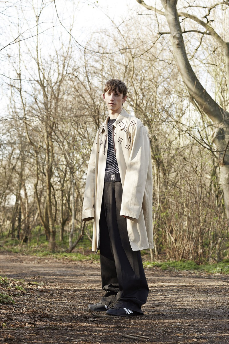 Max Townsend wears all clothes Raf Simons and sneakers Adidas by Raf Simons.