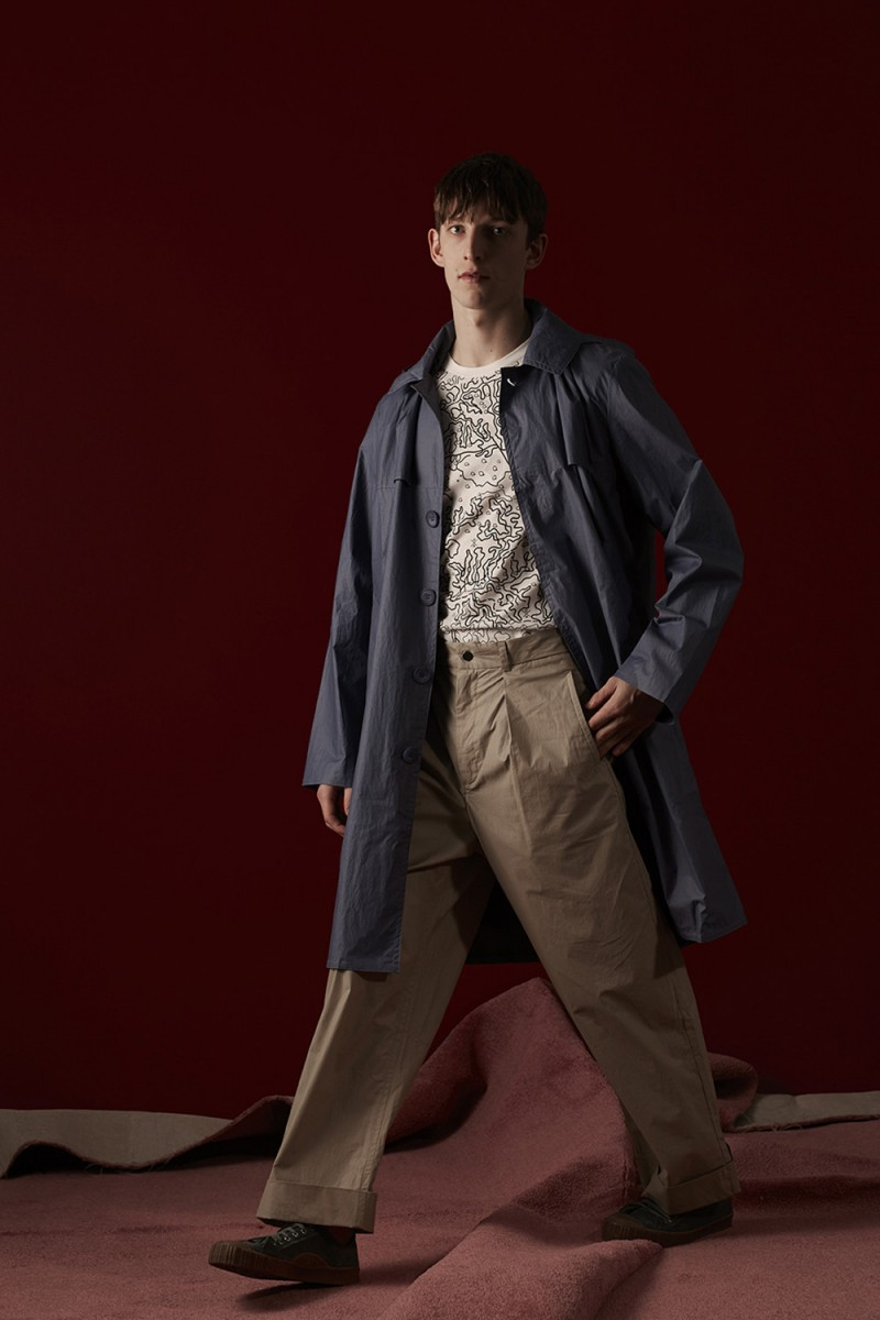 Max Townsend wears all clothes Christopher Raeburn and canvas high-top sneakers Adieu.