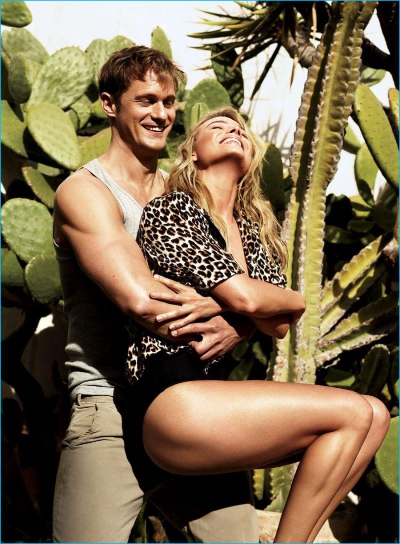 Alexander Skarsgård rocks a Calvin Klein tank as he embraces Margot Robbie.