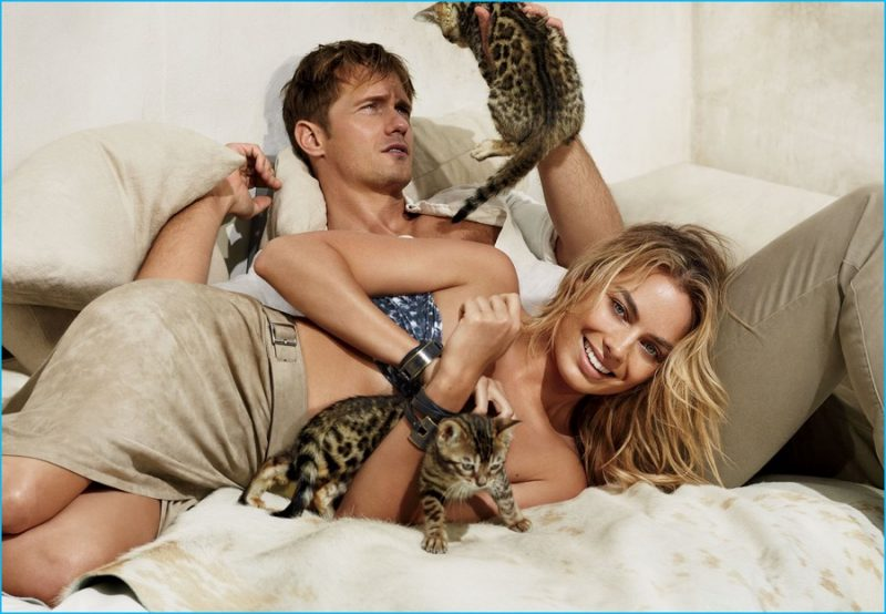 Photographed in bed for American Vogue, Margot Robbie and Alexander Skarsgård play with cats.