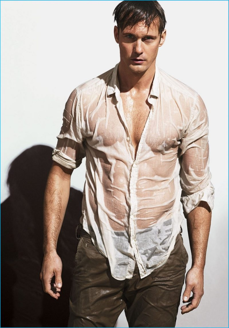 Alexander Skarsgård dons a wet shirt from Theory with Save Khaki United trousers.