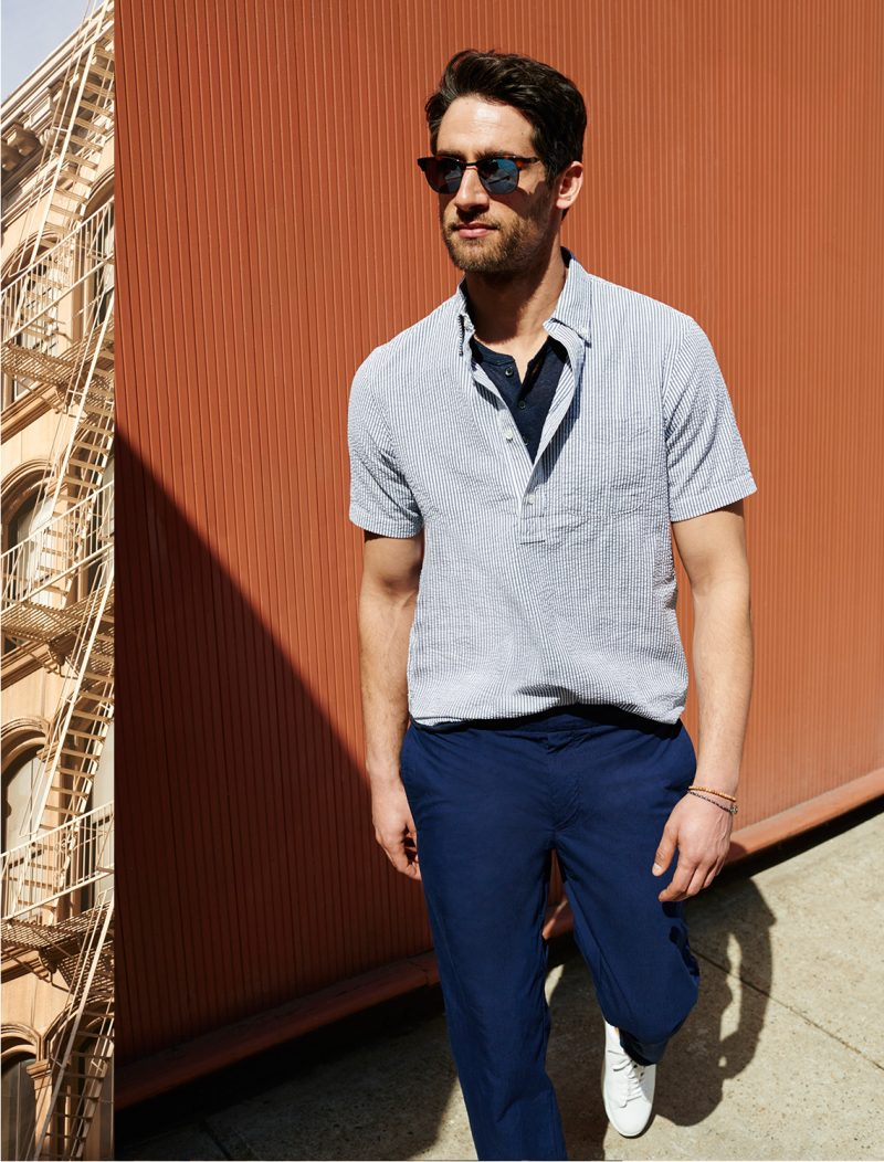 Club Monaco henley shirt, striped popover shirt, Rip-Stop joggers and Wings + Horns low-top sneakers.