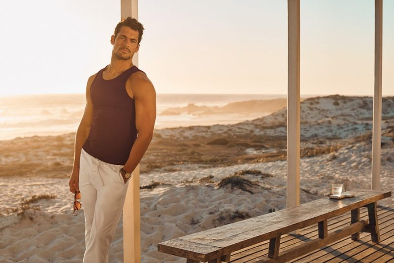David Gandy sports a tank and beach joggers from his Autograph Beachwear collection.