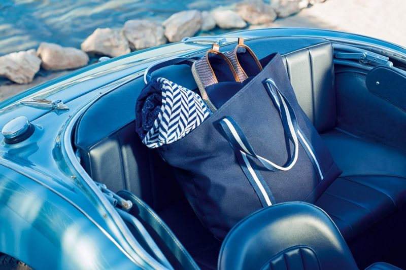 """David Gandy's """"man bag"""" with espadrilles and a beach towel from his Autograph Beachwear line."""