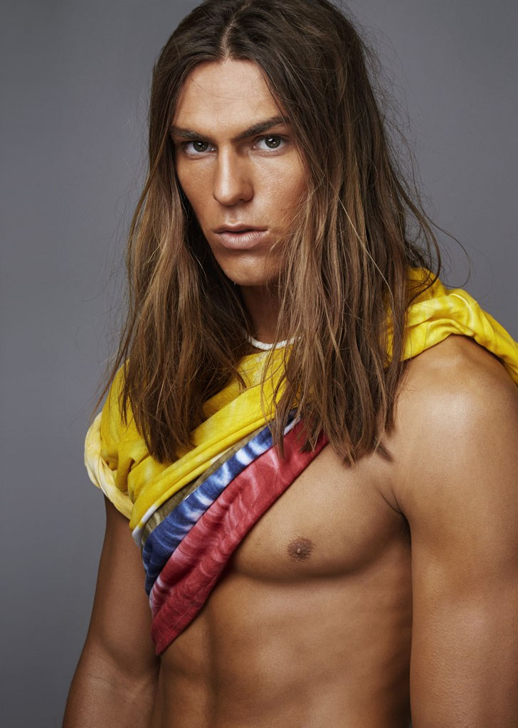 Travis Smith perfects his surfer look with grooming by Riad Azar.