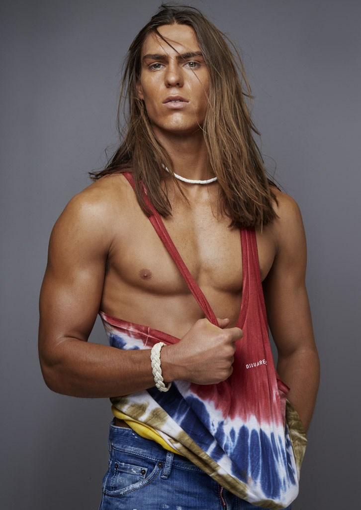 Travis Smith pictured in a tie-dye singlet from Dsquared2.