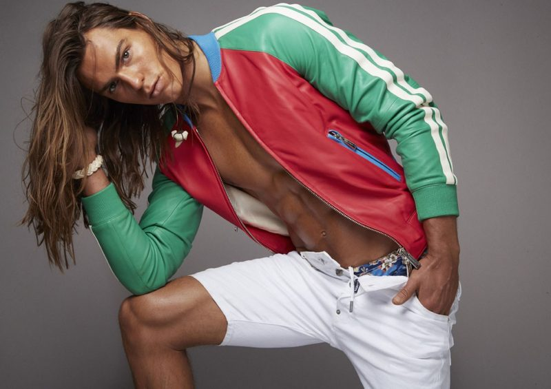 Travis Smith brings the color in a colorblocked leather jacket from Dsquared2.