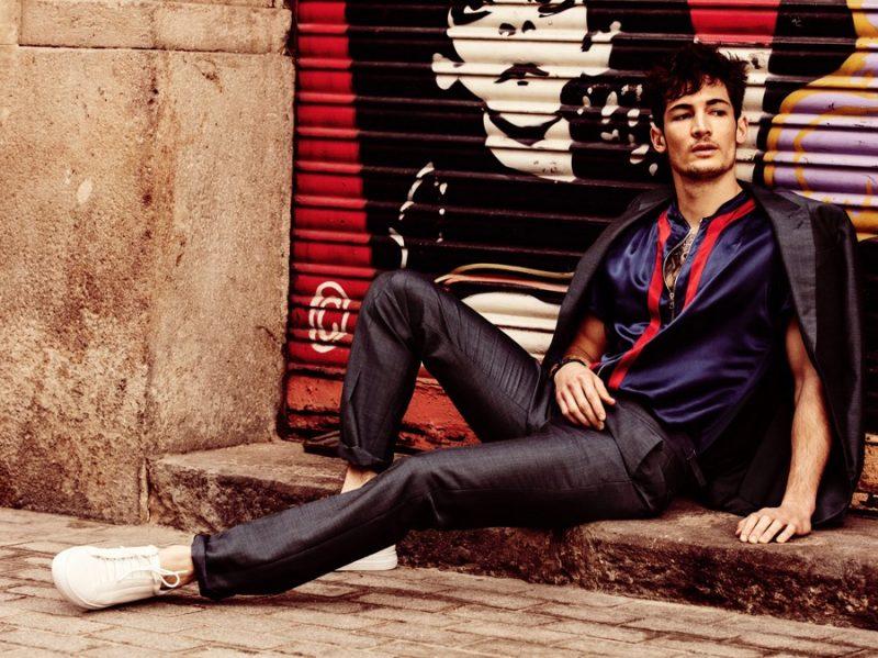 Kévin Drelon dons a Louis Vuitton suit from the brand's spring-summer 2016 men's collection.