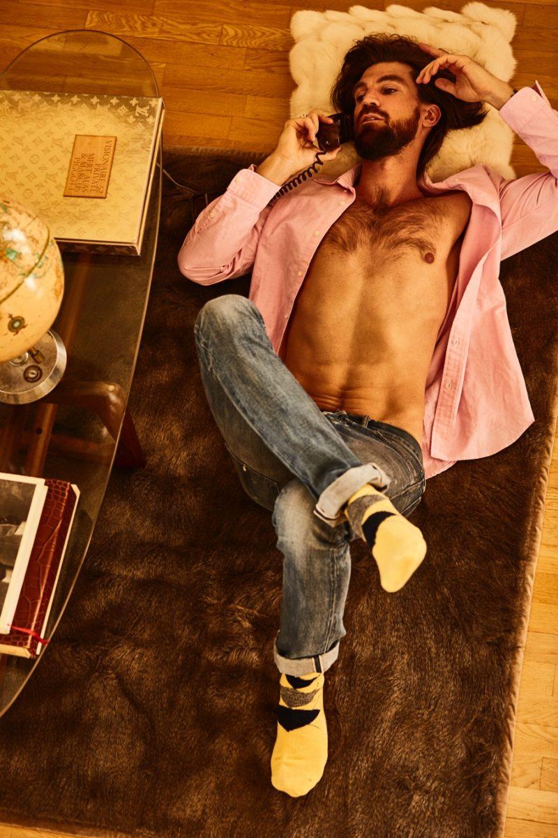 Going casual in Polo Ralph Lauren, Henrik Fallenius is captured on the phone.
